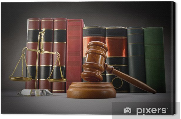 Scales of justice, law books and gavel over dark background Canvas Print