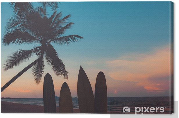 Silhouette surfboard on tropical beach at sunset in summer. Seascape of summer beach and palm tree at sunset. Vintage color tone Canvas Print - Sports