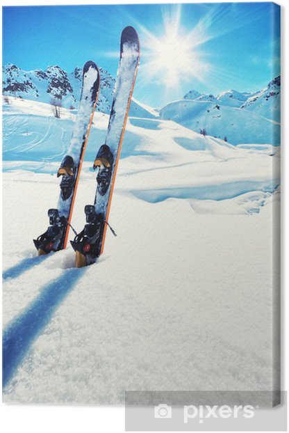 Skis in snow at Mountains Canvas Print - Skiing