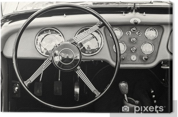 Steering wheel and dashboard in historic vintage car Canvas Print - Transport