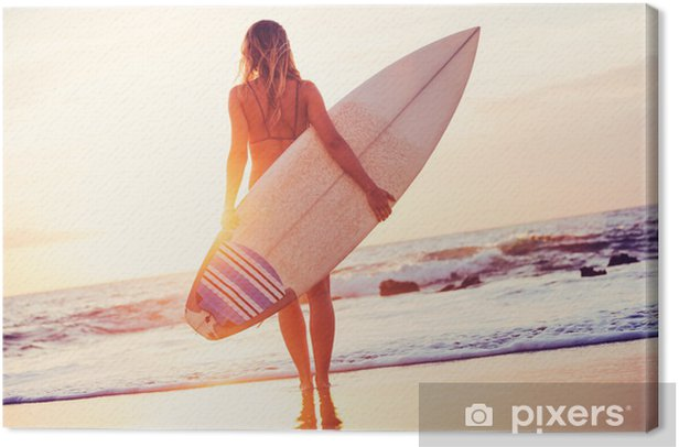 Surfer girl on the beach at sunset Canvas Print - Health