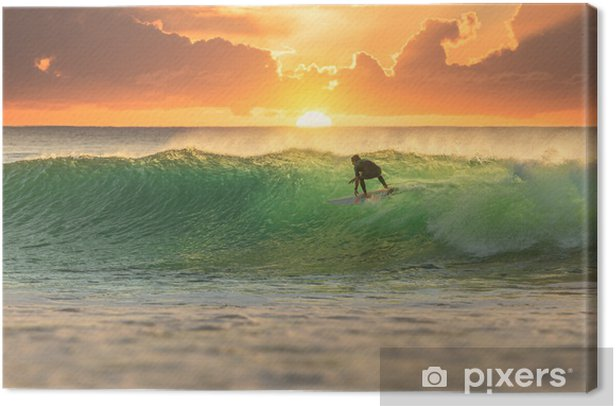 Surfer surfing at sunrise Canvas Print - iStaging
