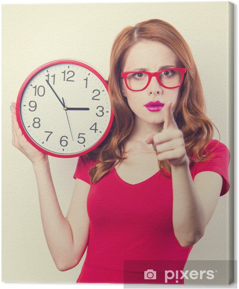 Surprised redhead girl with huge alarm clock on light background Canvas  Print