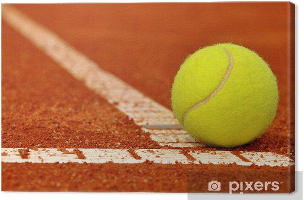 Tennis ball on a tennis clay court Canvas Print - Tennis