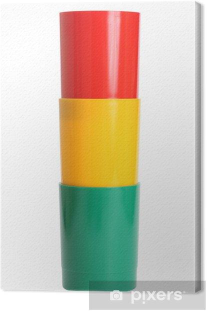 three colored plastic glasses Canvas Print - Fashion