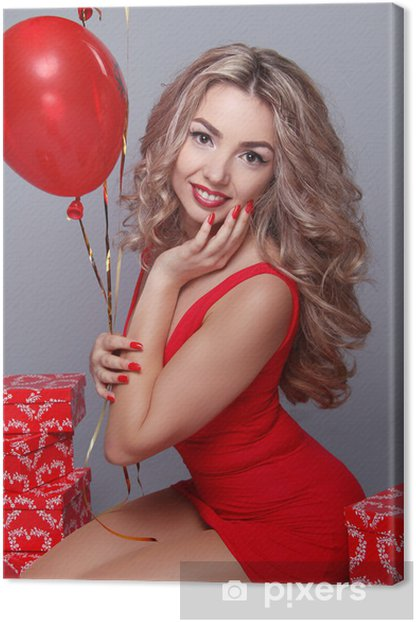 Valentine's Day. Beautiful happy woman with red heart balloons o Canvas Print - International Celebrations
