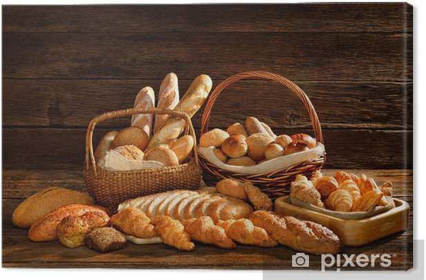 Variety of bread in wicker basket on old wooden background. Canvas Print - Themes