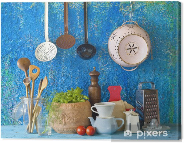 Various Vintage Kitchen Utensils Against Blue Wall Canvas Print
