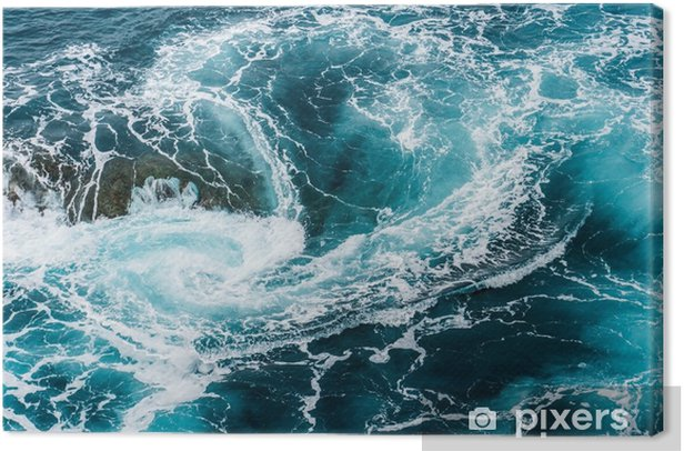 vertiginous, swirling foamy water waves at the ocean photographed from above Canvas Print - Landscapes