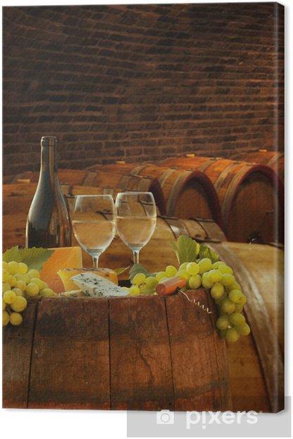 Vine cellar with glasses of white vine against barrels Canvas Print - Europe