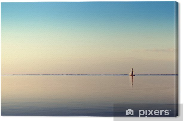 Water landscape with white sailing boat on calm waters in the light of the sunset. Toned and processing photos. Canvas Print - Landscapes