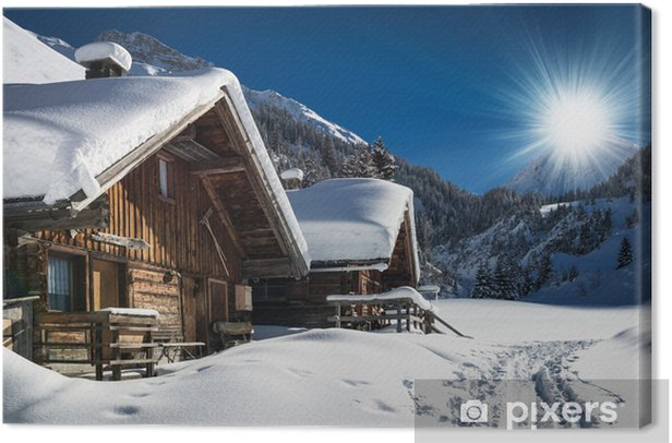 winter ski chalet and cabin in snow mountain landscape in tyrol Canvas Print - iStaging
