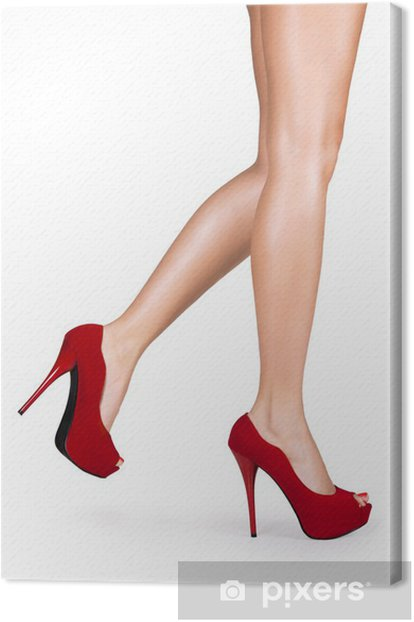 Woman legs wearing red high heels isolated on white background. Canvas Print - Themes