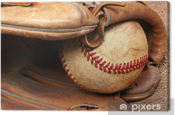Worn and used baseball in the pocket of a baseball mitt. Canvas Print - Individual Sports