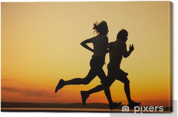 Young couple run together on a sunset Canvas Print - Themes
