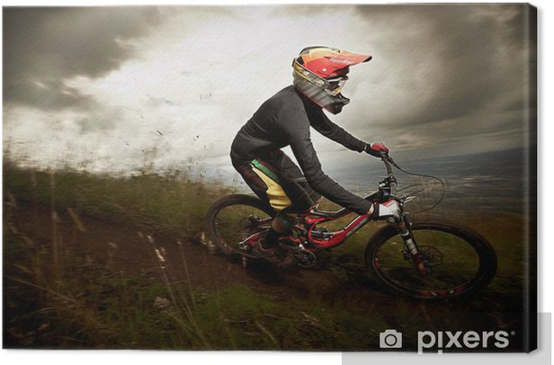 Young man riding a mountain bike downhill style Canvas Print - Cycling
