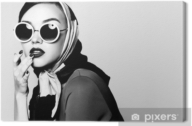 Young woman in retro style. Sunglasses and silk scarf. Canvas Print - People