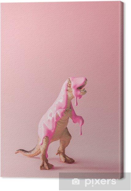 Canvas Roze verf druipend op speelgoed van de dinosaurus. creatief minimaal concept. - Dieren