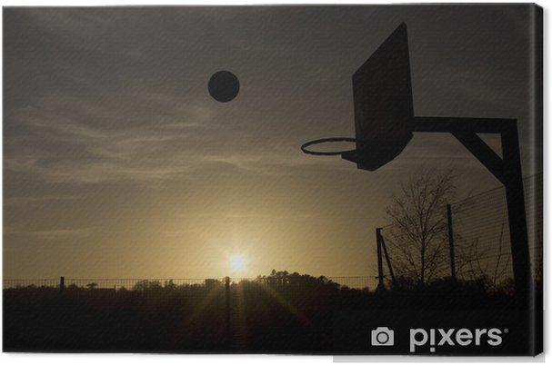 Canvas Silhouet van een basketbal in de lucht tijdens zonsondergang - Basketbal