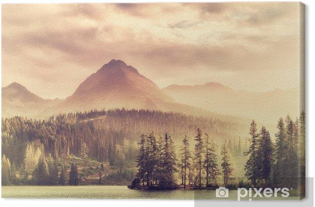 Canvas Vintage zonsondergang over een meer in de bergen - Landschappen