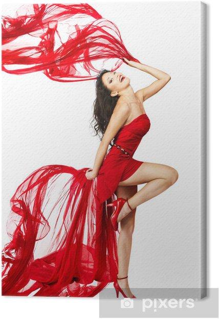 d5a35ca8f9cbe6 Canvas Vrouw in rode jurk dansen met stof vliegen op een luchtstroming.