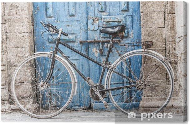 Canvas Witte fiets voor een winkel in Marrakech, Marokko - Fietsen