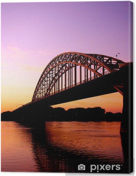 Canvas Zonsondergang bij Nijmegen, brug over de Waal - Vakantie