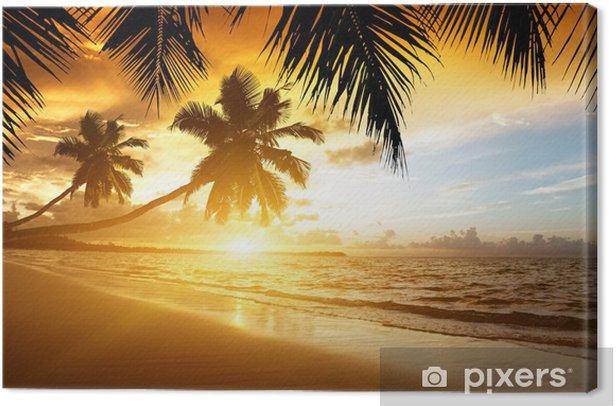 Canvas zonsondergang boven de Caribische zee - Palmbomen