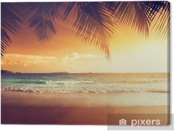 Canvas Zonsondergang op het strand van de Caribische zee - Palmbomen