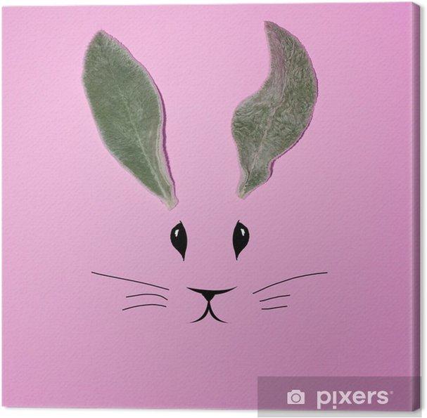 Canvastavla Kaninöron från bladen på en rosa bakgrund - Grafiska resurser