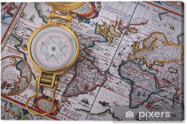 Canvastavla Kompass och vintagekarta på ett träbord. - Resor