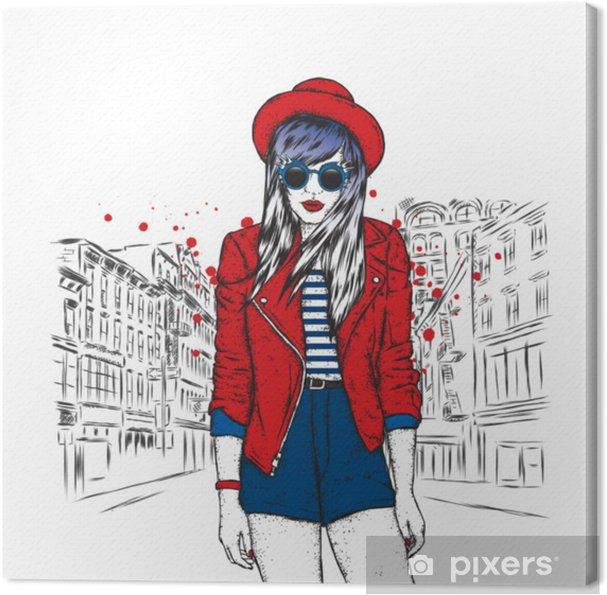 0bc157e0a184 Canvastavla Vacker tjej i en hatt, jacka och shorts. vektor illustration.  mode. slank flicka med långt hår i snygga kläder och tillbehör.