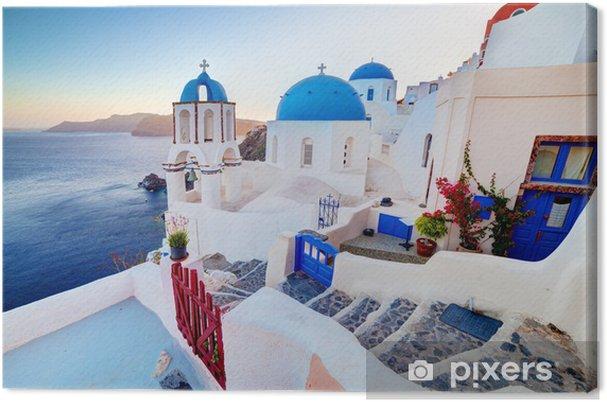Cuadro en Lienzo Ciudad de Oia en la isla de Santorini, Grecia en la puesta del sol. Mar Egeo. - Temas