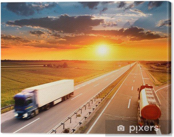 Cuadro en Lienzo Dos camiones en el desenfoque de movimiento en la carretera - Temas