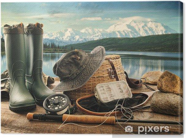 Cuadro en Lienzo Equipo de pesca con mosca en la cubierta con vistas a un lago y las montañas - Deportes de exterior