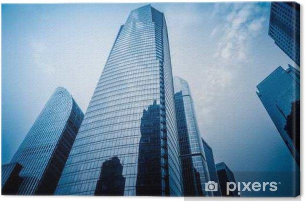 Cuadro en Lienzo Fachada de rascacielos, bajo ángulo de vista, la imagen en tonos azul. - Negocios