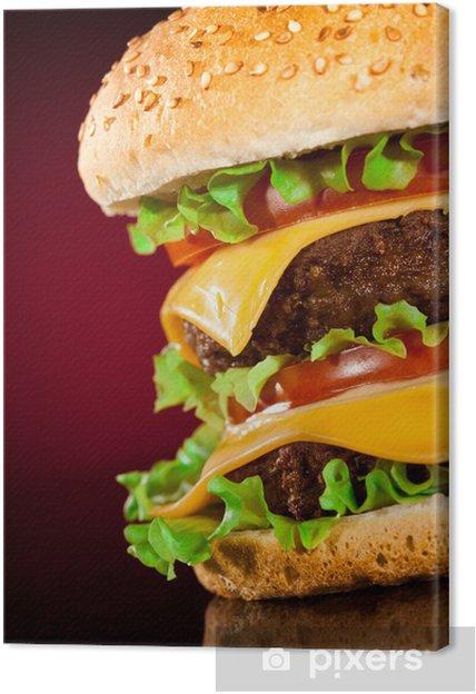 Cuadro en Lienzo Hamburguesa sabrosa y apetitosa en un rojo oscuro - Temas