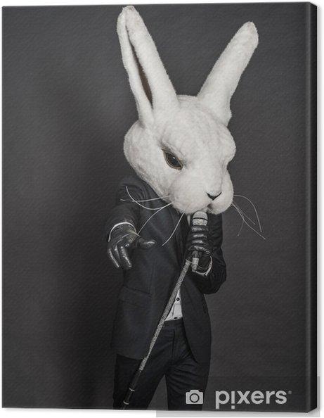Cuadro en Lienzo Hombre de la máscara de conejo. traje negro canta en el  fondo ad31d113db0