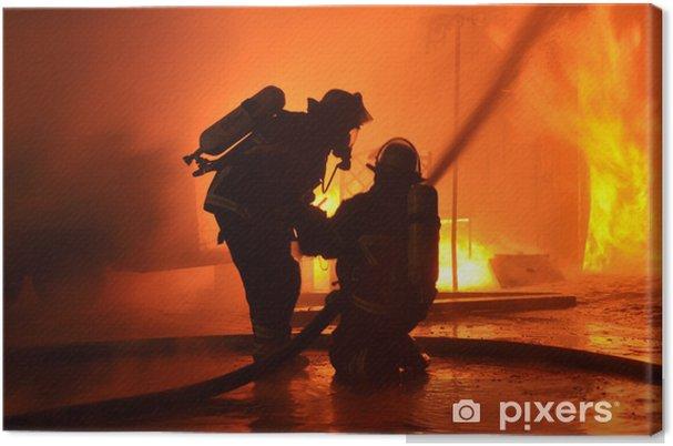 Cuadro en Lienzo Los bomberos de la pared de llamas - Profesiónes