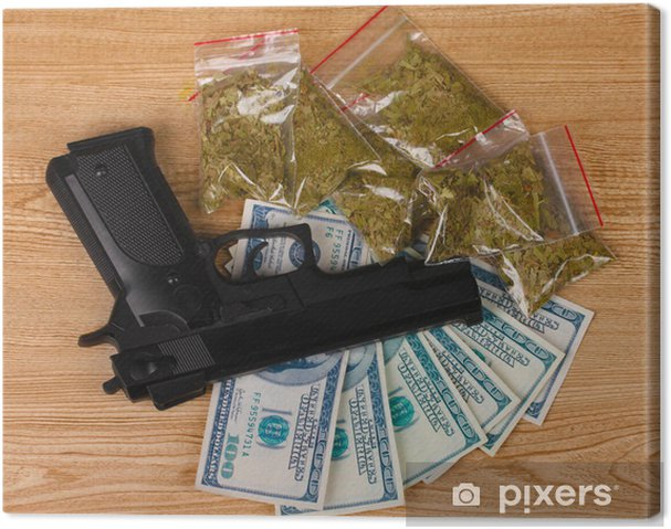 Cuadro en Lienzo Marihuana en paquetes, dólares y armas de mano sobre fondo de madera - Por carretera