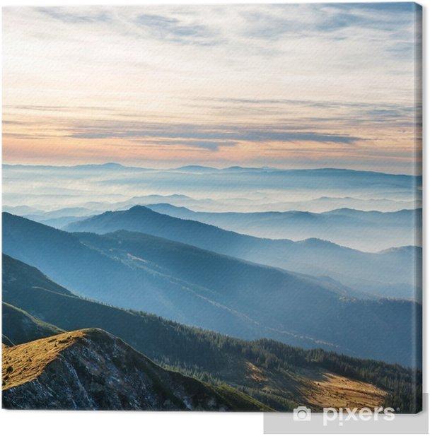 Cuadro en Lienzo Montañas azules y colinas sobre puesta del sol - Paisajes