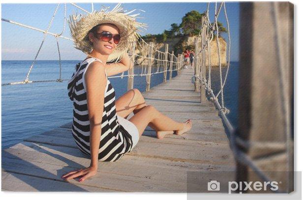 Cuadro en Lienzo Mujer atractiva en el puente de madera, Zakynthos, Grecia - Vacaciones
