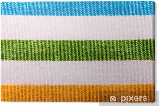 Cuadro en Lienzo Primer plano de la materia textil de rayas de colores como fondo o textura - Texturas