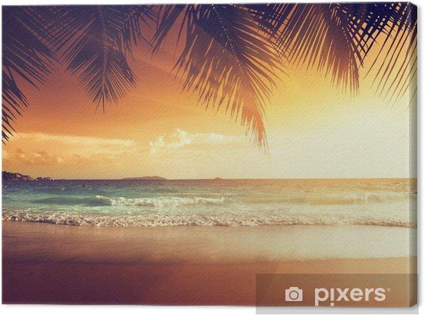 Cuadro en Lienzo Puesta de sol en la playa del mar Caribe - Palmeras