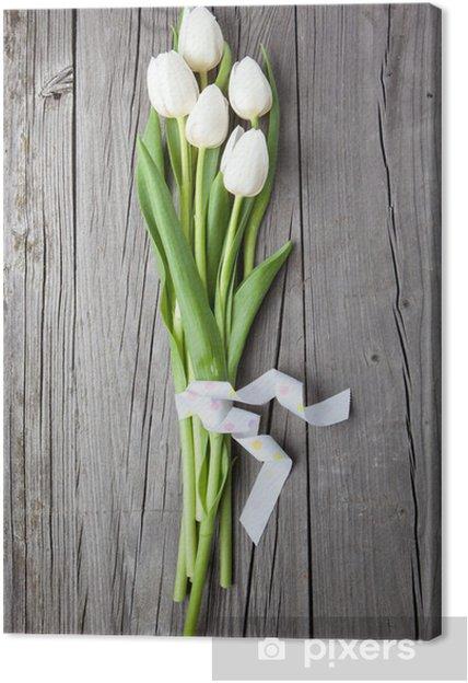 Cuadro en Lienzo Ramo de tulipanes blancos en la mesa de madera - Temas