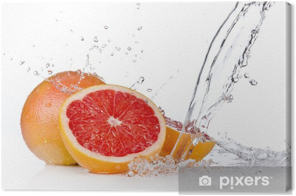 Cuadro en Lienzo Rodaja de pomelo en el chapoteo del agua, aislado en fondo blanco - Frutas