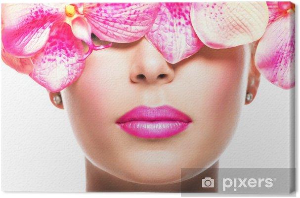 Cuadro en Lienzo Rostro de mujer con lápiz labial brillante en un Labios y flores de color rosa - Boca