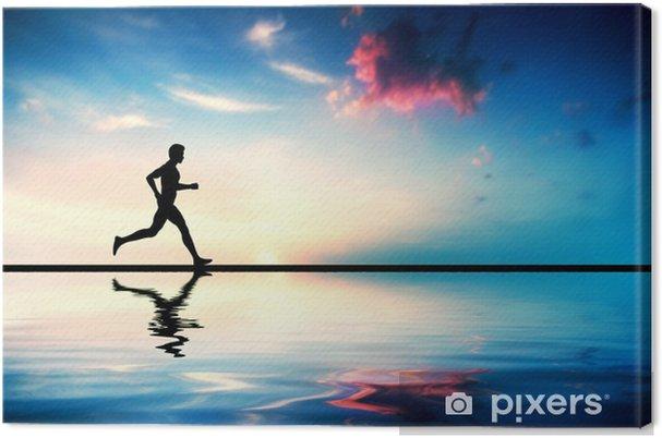 Cuadro en Lienzo Silueta del hombre corriendo al atardecer. Reflexión del agua - Salud