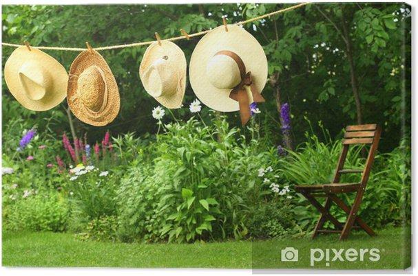 Cuadro en Lienzo Sombreros de paja del verano ropa colgando - Entretenimiento