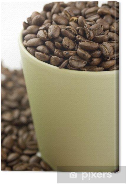 Cuadro en Lienzo Taza de café llena de granos de café - Temas
